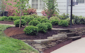 A small retaining wall can help a problem landscape become a beautiful focal point.